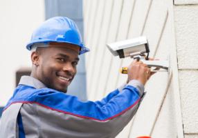 Handyman installing security camera